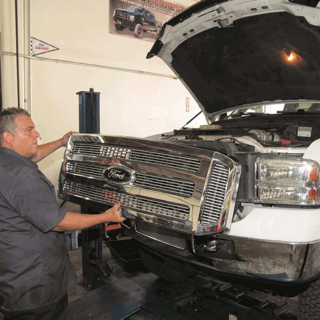 john ferguson repairing ford truck